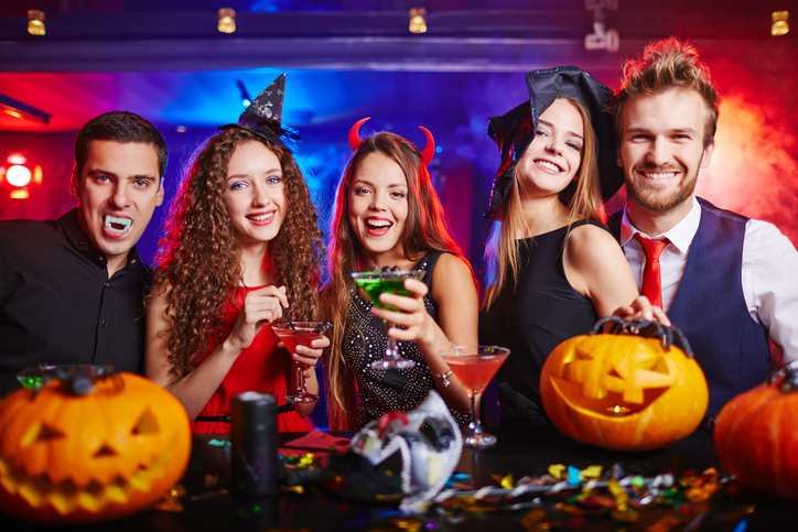 Guests Drinking at Halloween Party